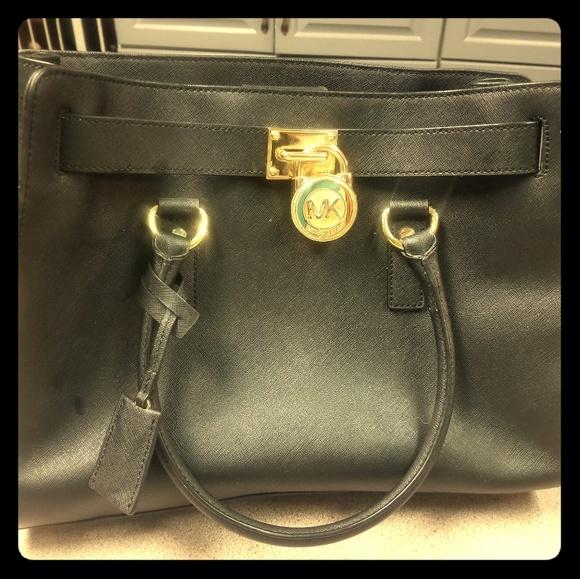 07b755d79c147f Michael Kors authentic purse from Dillards. M_5cbf2cfb8d6f1a49d4abe1a7